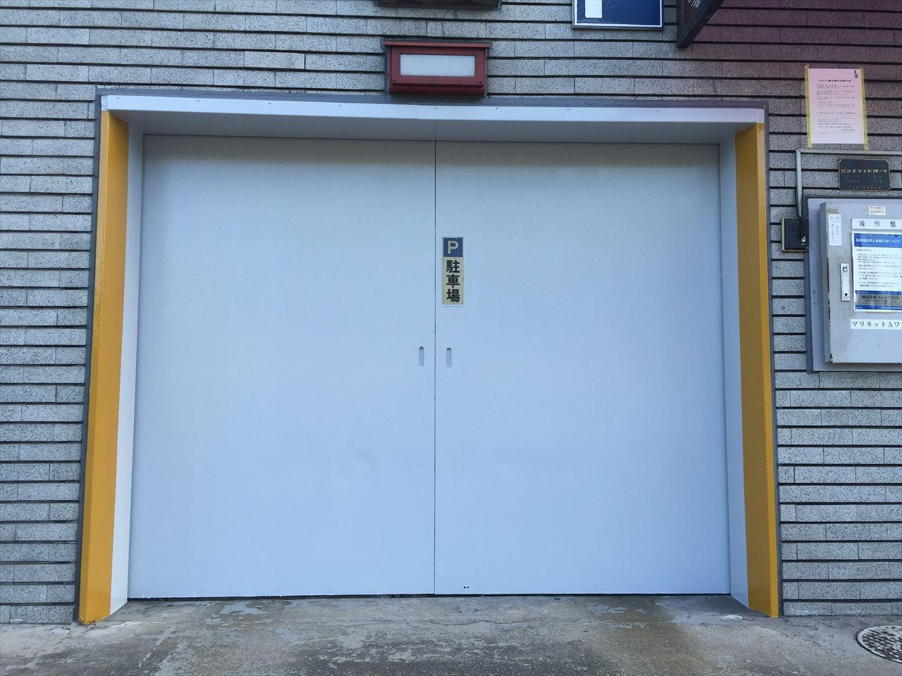 南区Aマンション立体駐車場扉の施工後写真その1